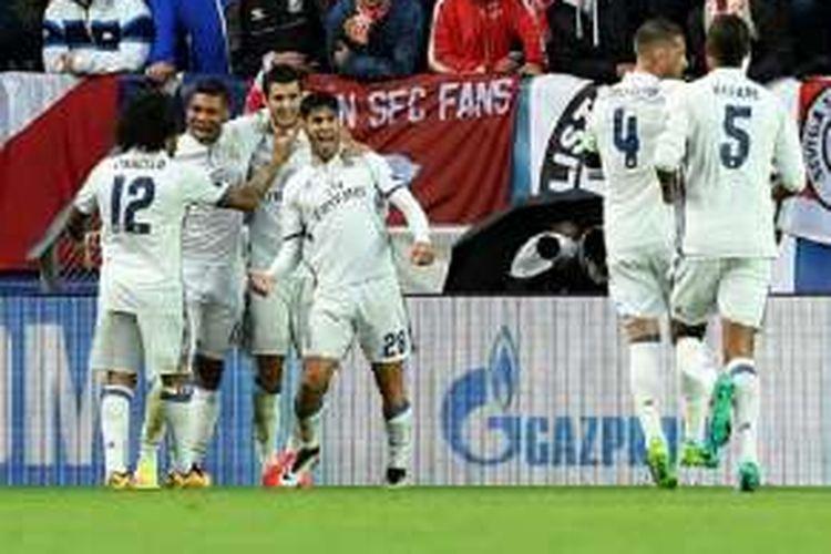 Marco Asensio merayakan gol Real Madrid ke gawang Sevilla pada laga Piala Super Eropa, Selasa (9/8/2016).