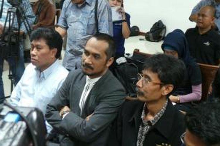 Ketua KPK Abraham Samad menghadiri sidang kasus dugaan korupsi proyek simulator SIM yang berlangsung di Pengadilan Tipikor, Jakarta, Jumat (12/7/2013).
