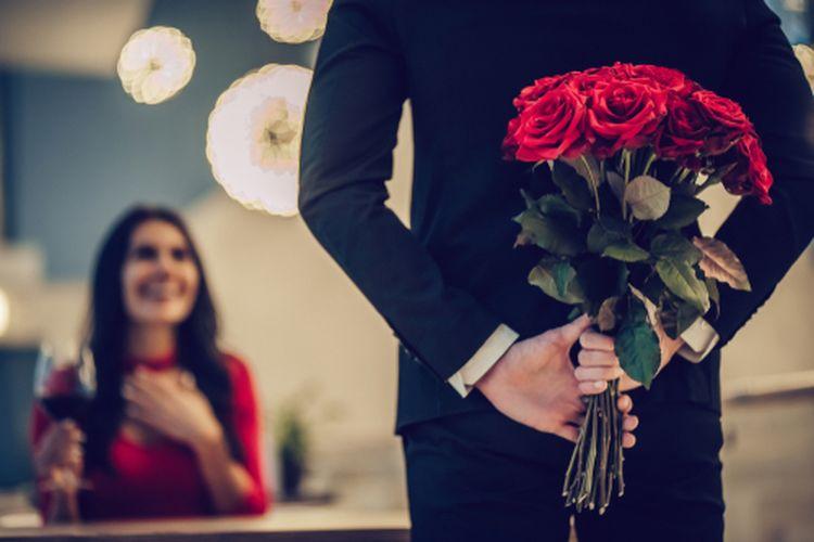 Ilustrasi seorang pria membawakan wanita seikat mawar merah.