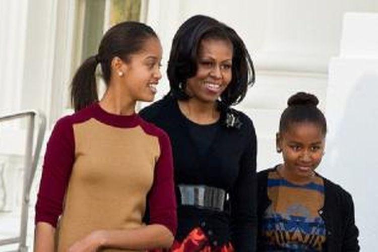 Michelle Obama dan dua putrinya