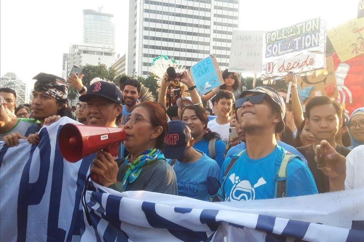 Menteri Kelautan dan Perikanan Susi Pudjiastuti ketika melakukan Pawai Anti Plastik di Jakarta, Minggu (21/7/2019).