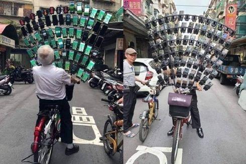 Kakek Ini Berburu Pokemon Go Pakai 64 Handphone di Sepeda