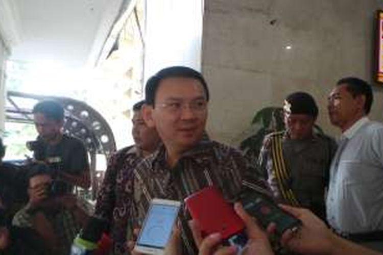 Gubernur DKI Jakarta Basuki Tjahaja Purnama seusai memberi keterangan terkait dugaan gratifikasi dalam pembelian lahan Cengkareng Barat, di Bareskrim Mabes Polri, Kamis (14/7/2016).
