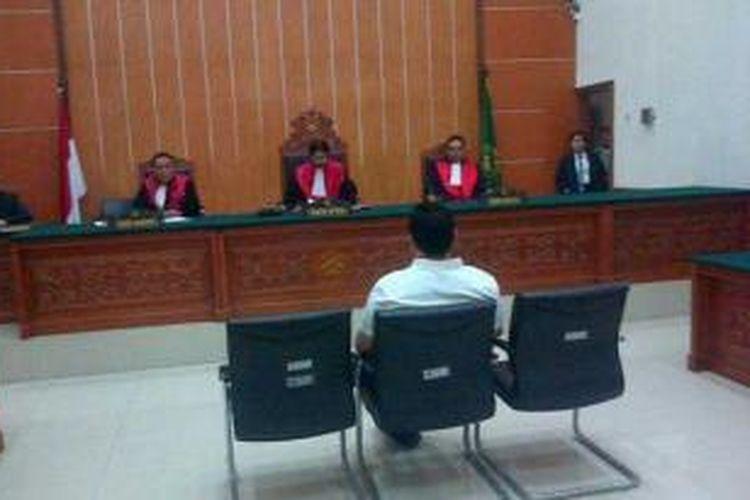 Terdakwa Freddy Budiman divonis hukuman mati dalam persidangan di Pengadilan Negeri Jakarta Barat, Senin (15/7/2013). Freddy terbukti menjadi pengedar jutaan butir ekstasi ke berbagai daerah.