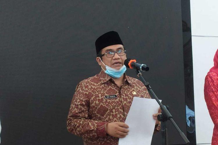 Kepala Kantor Kementerian Agama (Kemenag) Palembang Deni Periansyah saat menggelar konfrensi pers, Jumat (7/5/2021).