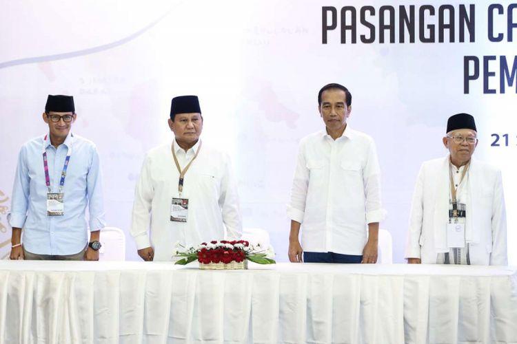 Dua pasangan calon presiden dan wakil presiden Prabowo Subianto - Sandiaga Uno dan Joko Widodo - Maruf Amin saat acara pengundian dan penetapan nomor urut pasangan calon presiden dan wakil presiden pemilu 2019 di Gedung Komisi Pemilhan Umum, Jakarta, Jumat (21/9/2019). Pasangan Joko Widodo - Maruf Amin mendapat nomor urut satu dan pasangan Prabowo Subianto - Sandiaga Uno mendapat nomor urut dua.