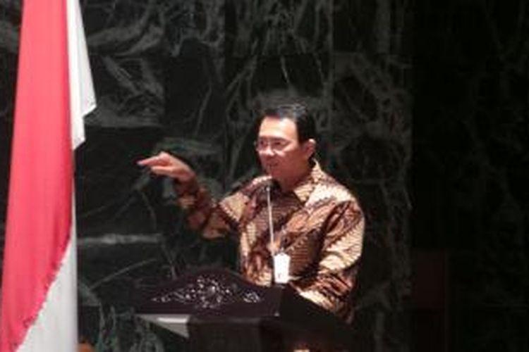 Gubernur DKI Jakarta Basuki Tjahaja Purnama saat menjadi narasumber dalam Talkshow Strategi Tata Kelola Anggaran yang Efektif, di Balaikota, Kamis (11/12/2014).