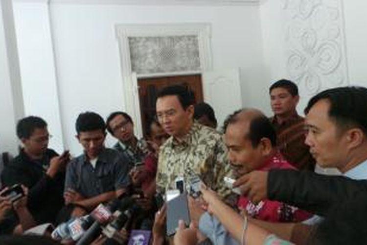 Gubernur DKI Jakarta Basuki Tjahaja Purnama bersama Menteri PPN/Kepala Bappenas Andrinof Chaniago, di Kantor Bappenas, Selasa (6/1/2015).