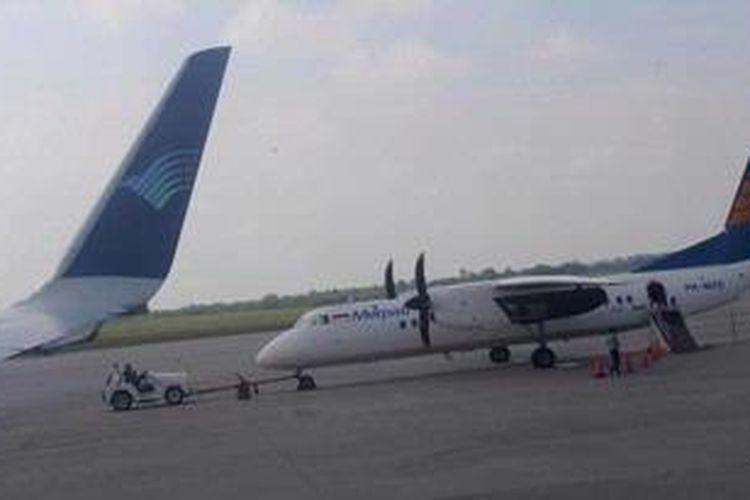 Ilustrasi: Pesawat Merpati Nusantara Airlines diparkir bersebelahan dengan pesawat Garuda Indonesia di Bandara Sultan Mahmud Badaruddin II, Palembang, Sumsel.