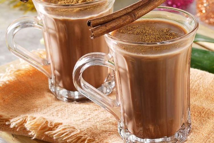 Ilustrasi susu cokelat rempah hangat.
