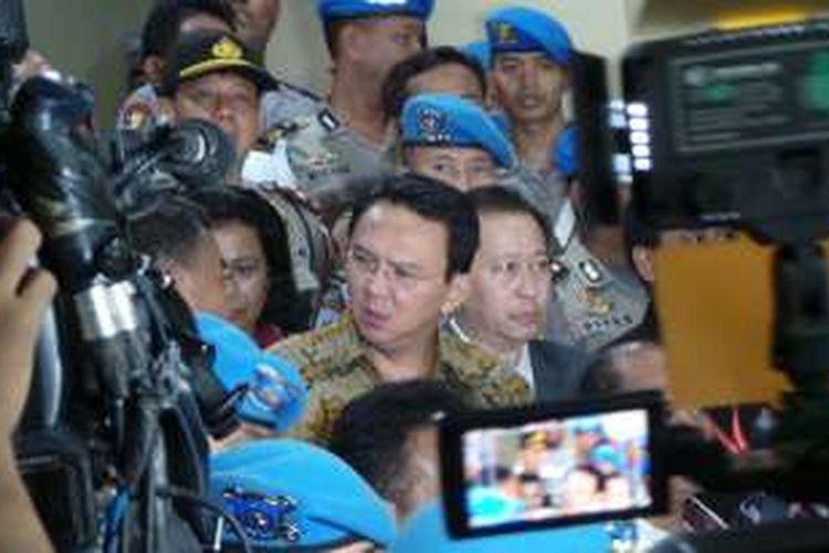 Tersangka kasus dugaan penistaan agama, Basuki Tjahaja Purnama atau Ahok, seusai diperiksa oleh Bareskrim Mabes Polri, Selasa (22/11/2016).