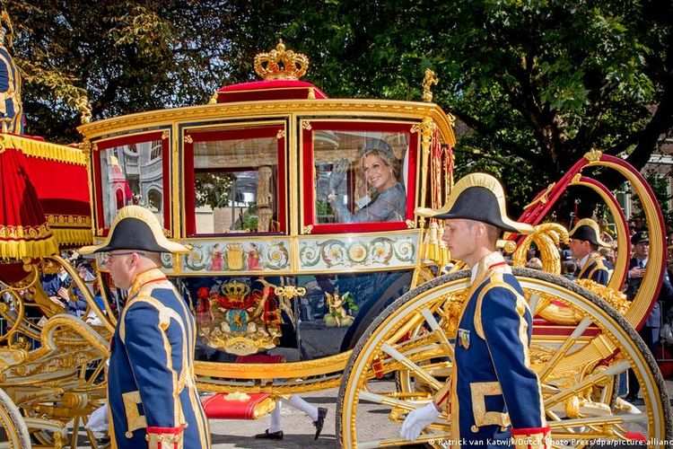 Queen Maxima of The Netherlands waves from the Glass Coach during Prinsjesdag, the annual opening of the parliamentary year