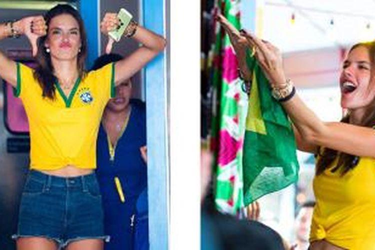 Supermodel Brasil, Alessandra Ambrosio, ketika mendukung timnas Brasil di semifinal Piala Dunia 2014, Selasa (8/7/2014).