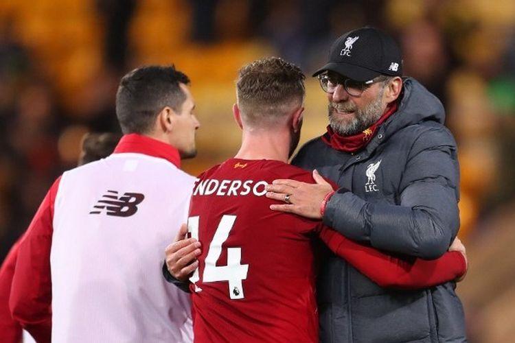 Jordan Henderson dan Juergen Klopp seusai laga Norwich City vs Liverpool di Carrow Road, Sabtu (15/2/2020).