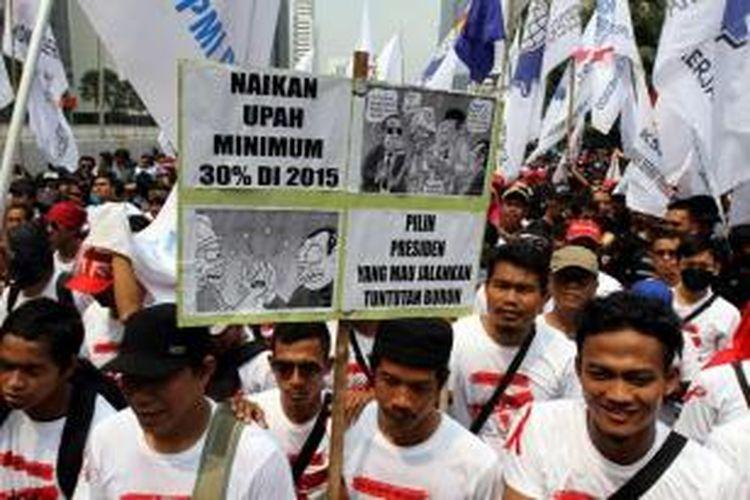 IlustrasI: Ribuan buruh menuntut upah layak dan penghapusan outsourcing