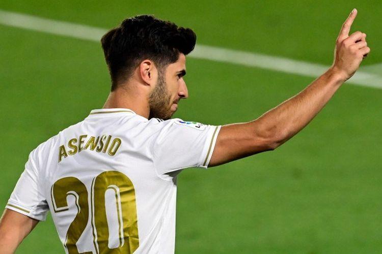 Marco Asensio merayakan gol bagi Real Madrid pada laga lanjutan Liga Spanyol kontra Valencia di Stadion Alfredo Di Stefano, Valdebebas, pada 19 Juni 2020 dini hari WIB.