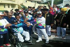 Seru, Masyarakat Ternate Antusias Sambut Kirab Obor Asian Para Games 2018