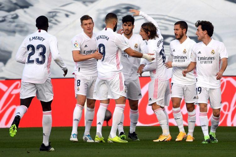 Real Madrid merayakan gol Marco Asensio dalam pertandingan Real Madrid vs Levante pada pekan ke-21 Liga Spanyol di Stadion Alfredo Di Stefano, Sabtu (30/1/2021).
