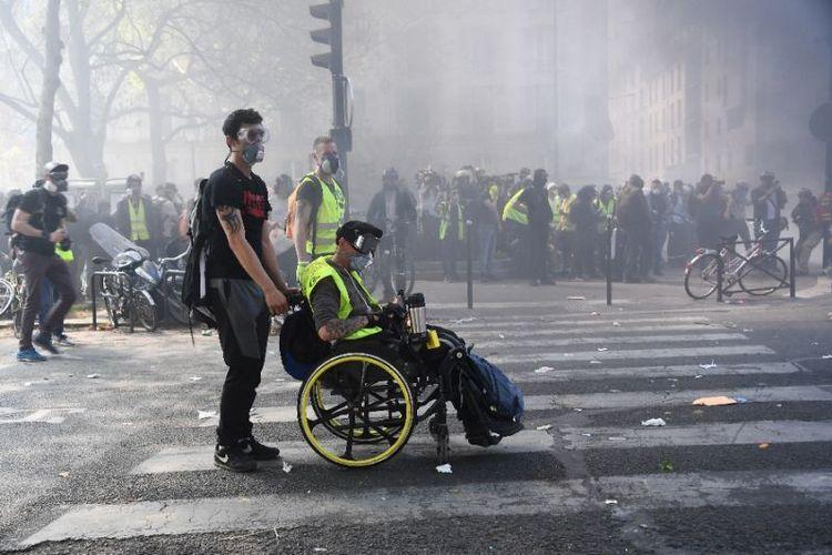 Aksi protes massa rompi kuning memasuki pekan ke-23 di Perancis. (AFP/Anne-Christine Poujaoulat)
