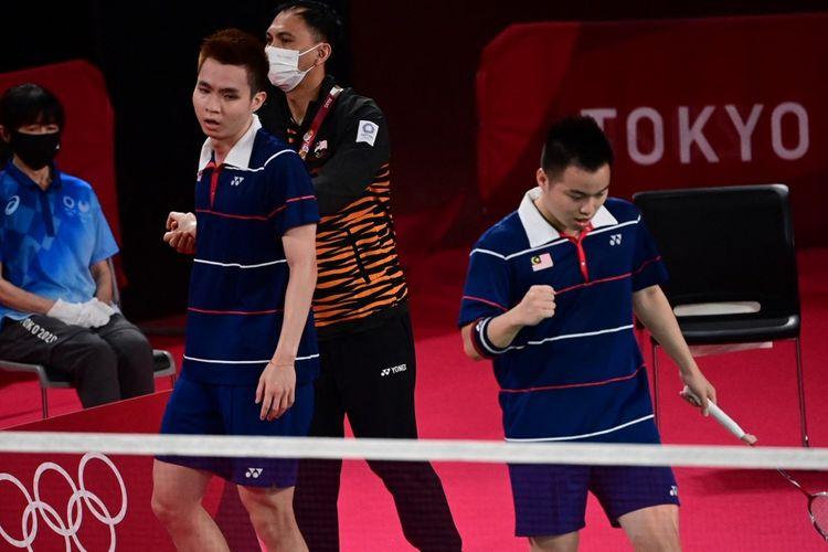 Pasangan Malaysia Aaron Chia/Soh Wooi Yik menghadirkan salah satu kejutan terbesar di Olimpiade Tokyo 2020 kala mengalahkan pasangan ganda putra nomor satu dunia Marcus Fernaldi Giden/Kevin Sanjaya Sukamuljo pada babak perempat final, Kamis (29/7/2021).