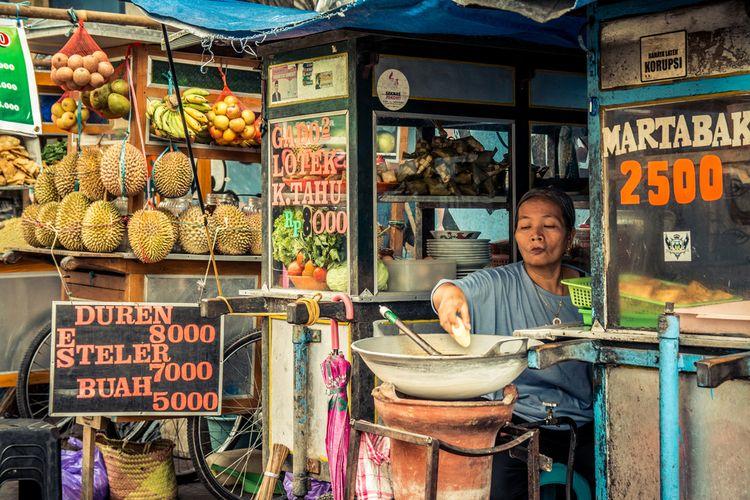 Ilustrasi penjual makanan pinggir jalan.