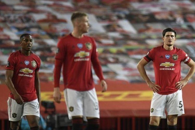 Ekspresi Anthony Martial (kiri) dan Harry Maguire (kanan) dalam laga Manchester United vs Southampton pada pekan ke-35 Liga Inggris 2019-2020.