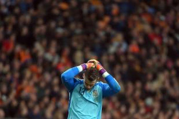Salah satu aksi kiper Manchester United Davd De Gea saat membela tim nasional Spanyol, pada pertandingan persahabatan melawan Belanda, di Amsterdam, 31 Maret 2015.