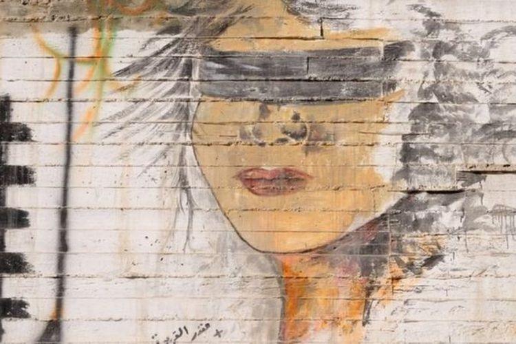 Ilustrasi kampanye anti-kekerasan terhadap perempuan.
