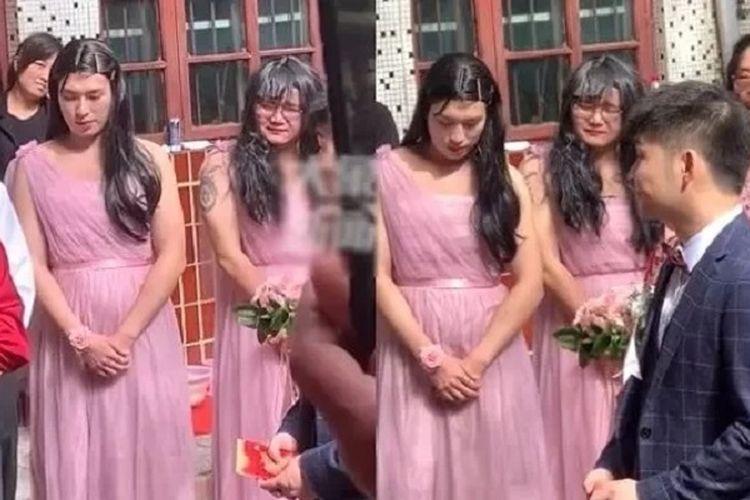 Inilah momen seorang pengiring pengantin wanita nampak canggung dan terus melihat ke bawah sepanjang upacara pernikahan. Yang membuat dahi mengernyit karena ketiga pengiring tersebut adalah pria.