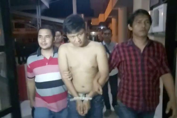 Suryadi alias Cung Adi (24),pelaku pembunuhan terhadap Usman Heri (35) ditangkap jajaran tim Tekab Polresta Palembang ditempat persembunyiannya, Selasa (30/4/2019).