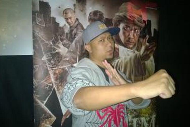 Sutradara film Anggy Umbara berpose usai jumpa pers perilisan trailer perdana film 3 garapannya di XXI Plaza Senayan, Senin (10/8/2015).