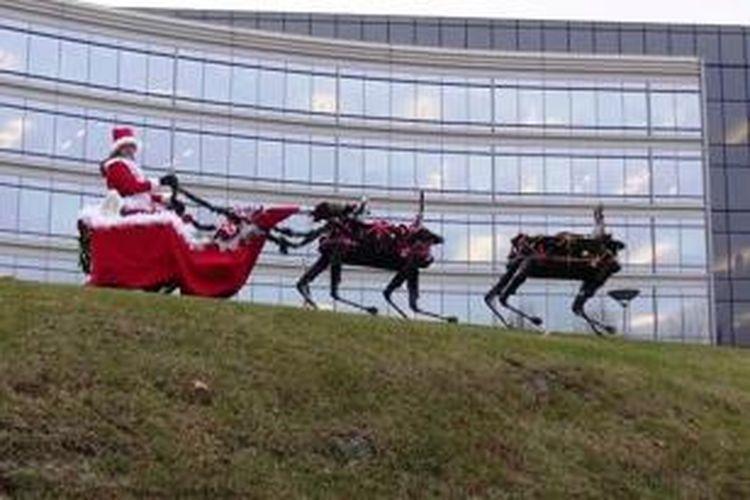 Robot rusa buatan Boston Dynamics menarik Sinterklas.