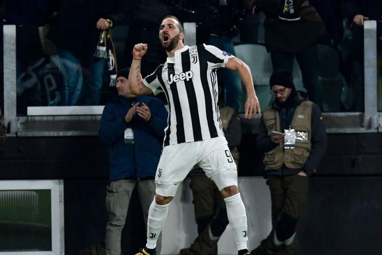 Gonzalo Higuain merayakan gol Juventus ke gawang Tottenham Hotspur pada pertandingan babak 16 besar Liga Champions, 13 Februari 2018.