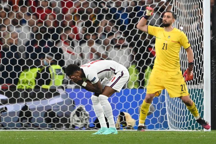 Ekspresi Marcus Rashford usai gagal menendang penalti dalam laga final Euro 2020 Italia vs Inggris di Stadion Wembley, London, Inggris, 11 Juli 2021.