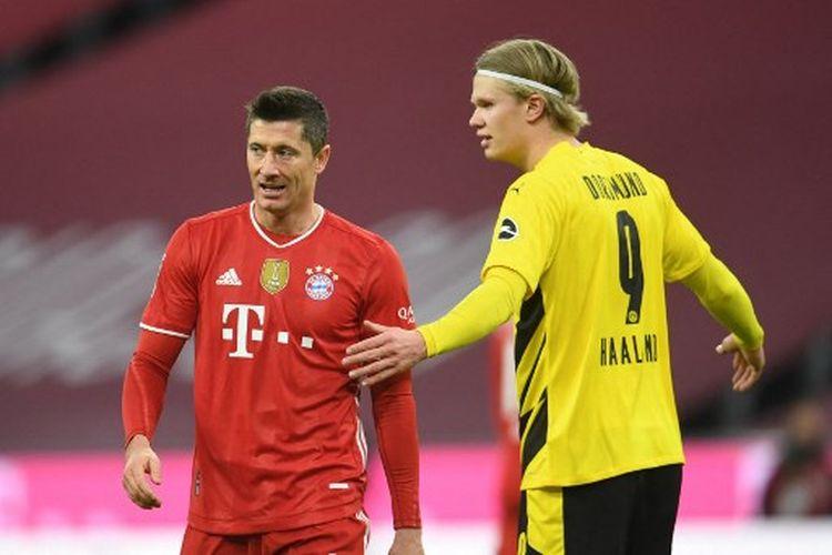 Robert Lewandowski (kiri) berduel melawan Erling Braut Haaland pada laga pekan ke-24 kasta teratas Liga Jerman, Bundesliga, yang mempertemukan Bayern Muenchen vs Borussia Dortmund di Stadion Allianz Arena, Minggu (7/3/2021) dini hari WIB.