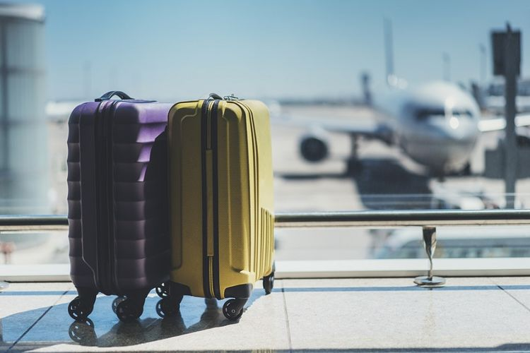 Ilustrasi koper barang bawaan di bandara.