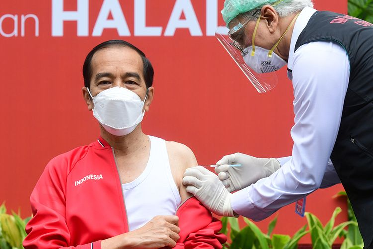 Indonesia's President Joko Widodo receives his second dose of the Covid-19 vaccine at the Merdeka Palace in Jakarta on Tuesday, January 27.