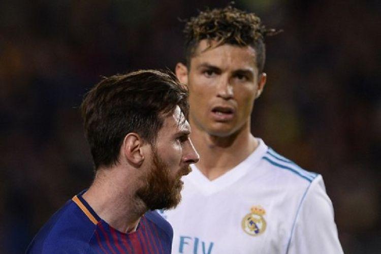Lionel Messi (kiri) dan Cristiano Ronaldo (kanan ) saat masih berseragam Real Madarid pada laga El Clasico di Stadion Camp Nou, 6 Mei 2018.