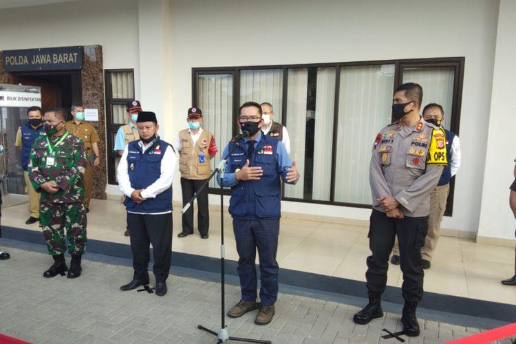 Gubernur Jawa Barat Ridwan Kamil saat menghadiri konferensi pers perkembangan Covid-19 di Mapolda Jabar, Kota Bandung, Selasa (16/6/2020).