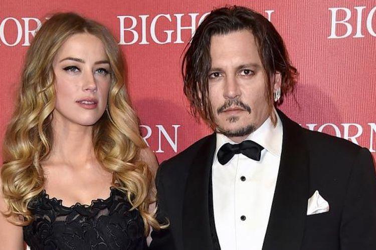 Pasangan Amber Heard (kiri) dan Johnny Depp (kanan) menghadiri Palm Springs International Film Festival Awards Gala di Palm Spring, California, pada 2 Januari 2016.