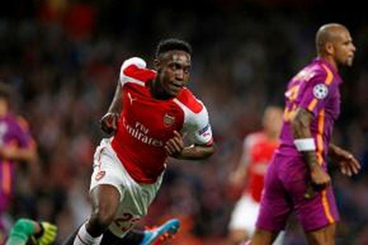 Striker Arsenal, Danny Welbeck, seusai mencetak gol ke gawang Galatasaray pada matchday kedua Grup D Liga Champions di Stadion Emirates, Rabu (1/10/2014).
