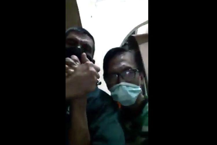 Tangkapan layar video ASN menerobos ruang isolasi Covid-19 di Lampung Utara. (FOTO: Tangkapan layar)
