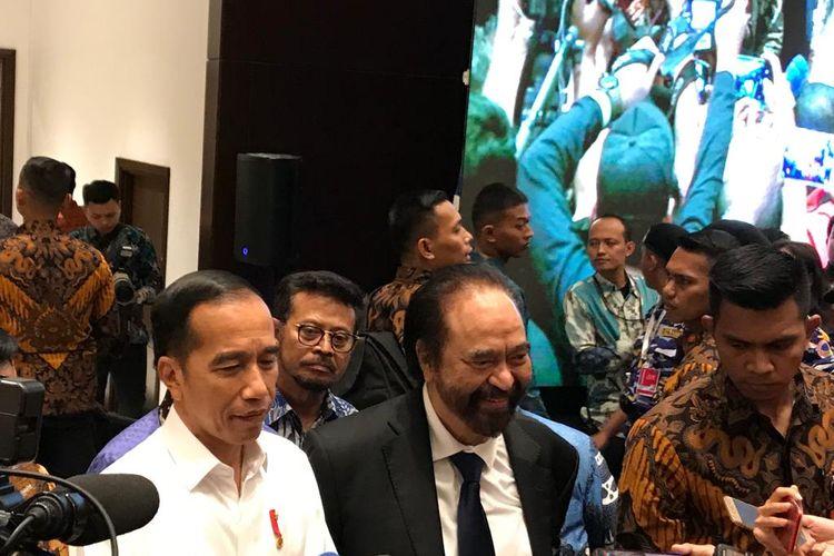 Presiden Joko Widodo bersama Ketua Umum Partai Nasdem Surya Paloh usai acara HUT Partai Nasdem di JI Expo Kemayoran, Jakarta, Senin (11/11/2019)