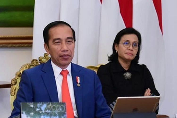 Presiden Joko Widodo didampingi Menkeu Sri Mulyani. ANTARA FOTO/HO/Biro Pers Sekretariat Presiden/Muchlis Jr/sgd/aww.