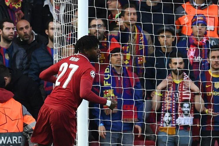 Divock Origi merayakan golnya pada pertandingan Liverpool vs Barcelona dalam semifinal Liga Champions di Stadion Anfield, 7 Mei 2019.