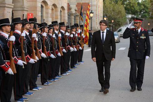 Dilema Polisi Catalonia: Patuhi Titah Raja atau Puigdemont