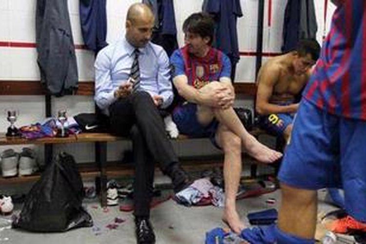 """Josep """"Pep"""" Guardiola (kiri) dan Lionel Messi sewaktu berkolaborasi bersama di Barcelona."""