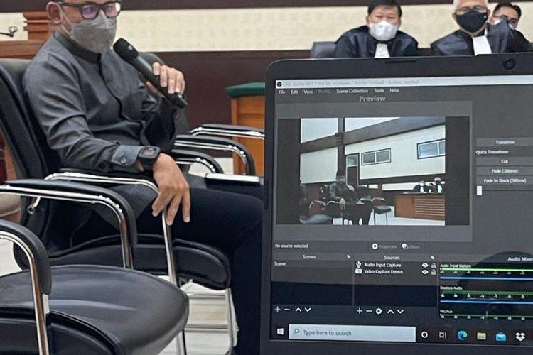 Wali Kota Bogor Bima Arya memberikan kesaksian dalam sidang kasus tes usap (swab test) palsu RS Ummi Bogor dengan terdakwa Rizieq Shihab. Sidang berlangsung di Pengadilan Negeri Jakarta Timur, Rabu (14/4/2021).(DOKUMENTASI TIM KUASA HUKUM RIZIEQ SHIHAB)