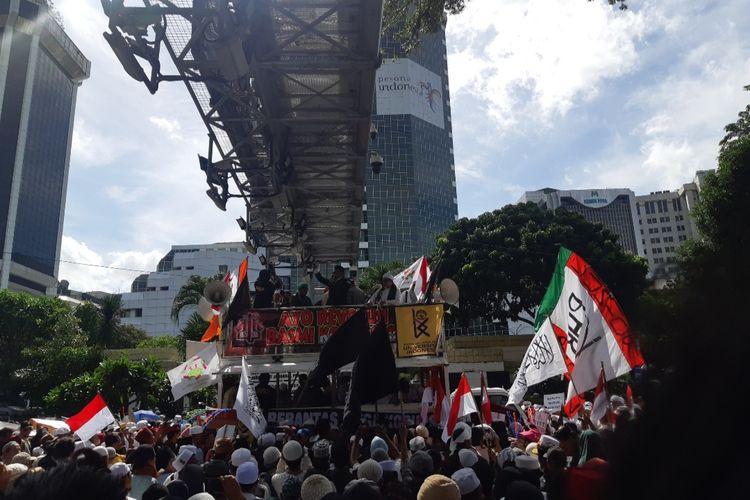 Massa dalam Aksi 212Berantas Korupsi di Jalan Medan Merdeka Barat, Jumat (21/2/2020)