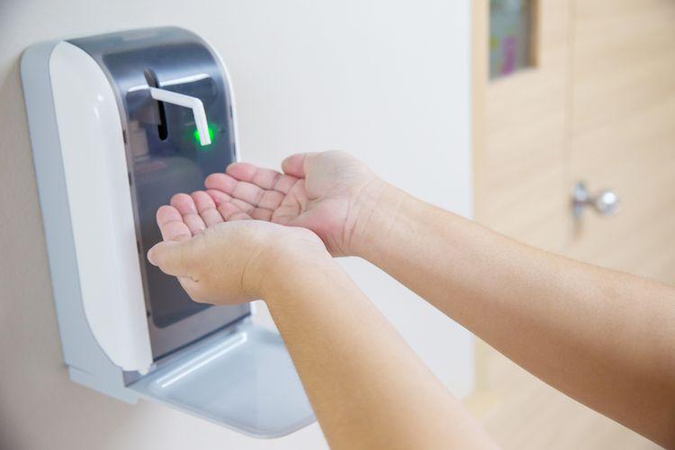 Ilustrasi mesin otomatis hand sanitizer.